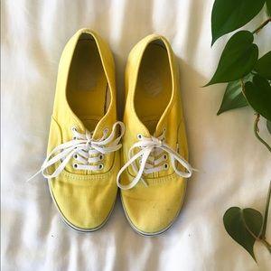 Yellow Vans tennis shoes